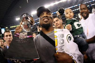 Charles Woodson holding the Lombardi trophy after the Packers beat the Steelers 31-25. February 6, 2011.