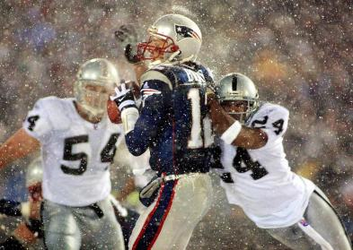 Charles Woodson tackling Tom Brady on what would be remembered as the Tuck Rule play. January 19, 2002.
